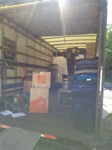 Local Movers in Holladay unloading moving truck